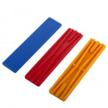 Blauwe, rode en gele kunststof blokjes